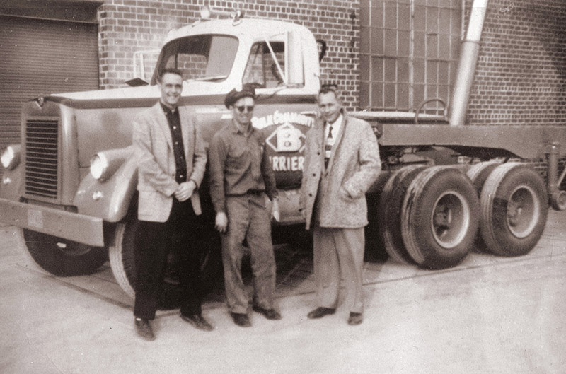 1958 – Pictured in the middle is Richard Johnson with one of his ten delivery trucks.
